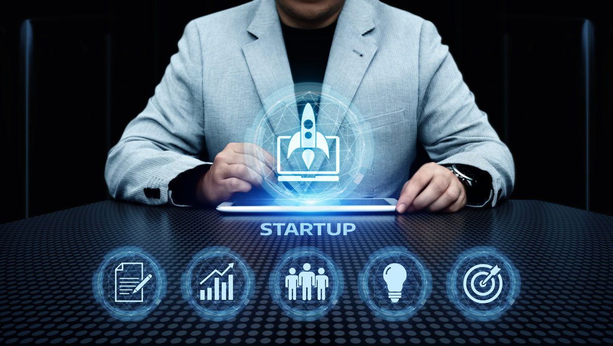 Man with tablet and the word startup